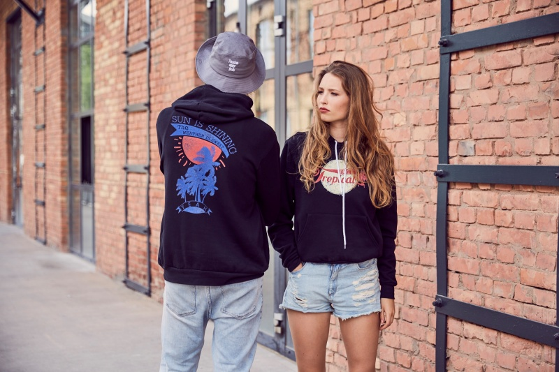 woman and a man in hoodies